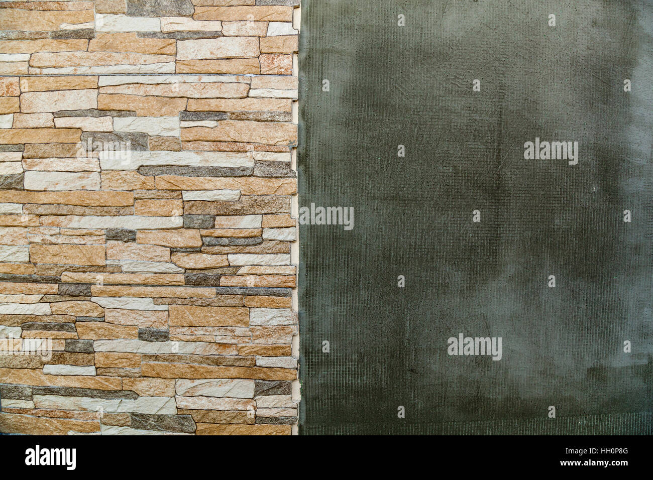 Brick and plaster. Brick and plaster wall as abstract background. - Stock Image