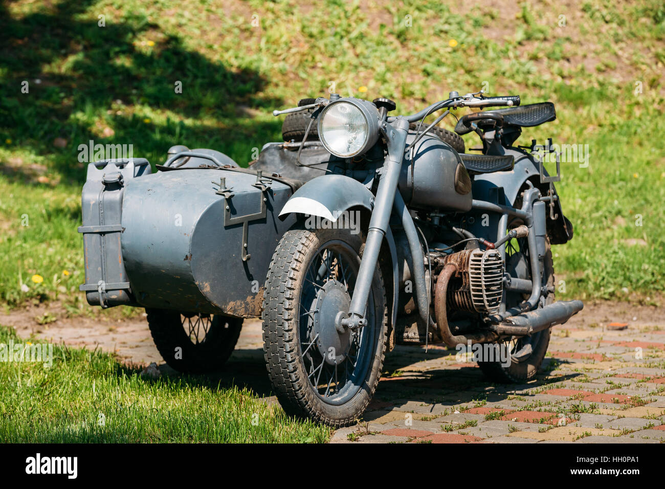 The Old Rarity Tricar, Three-Wheeled Gray Motorcycle With A Sidecar Of German Forces Of World War 2 Time Standing - Stock Image