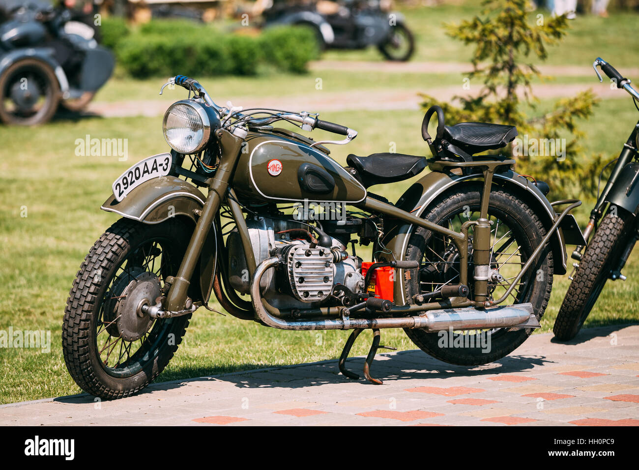 Gomel, Belarus - May 9, 2016: IMZ M-52 Ural, The Old Rarity Soviet Two-Wheeled Khaki Motorcycle, Standing On The - Stock Image