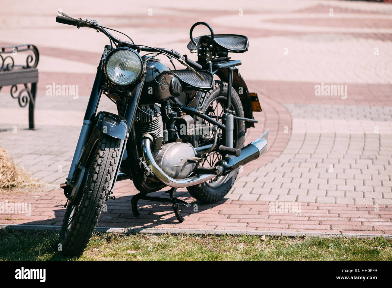Gomel, Belarus - May 9, 2016: IZH-49, The Old Rarity Soviet Road Two-Wheeled Black Motorcycle, Standing On The Pavement - Stock Image