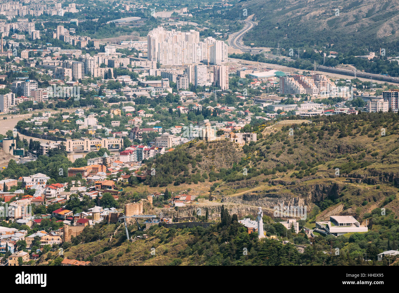 Tbilisi Georgia. Aerial View Of City With Famous Landmarks: Kartlis Deda Monument, Narikala Ancient Fortress And Stock Photo