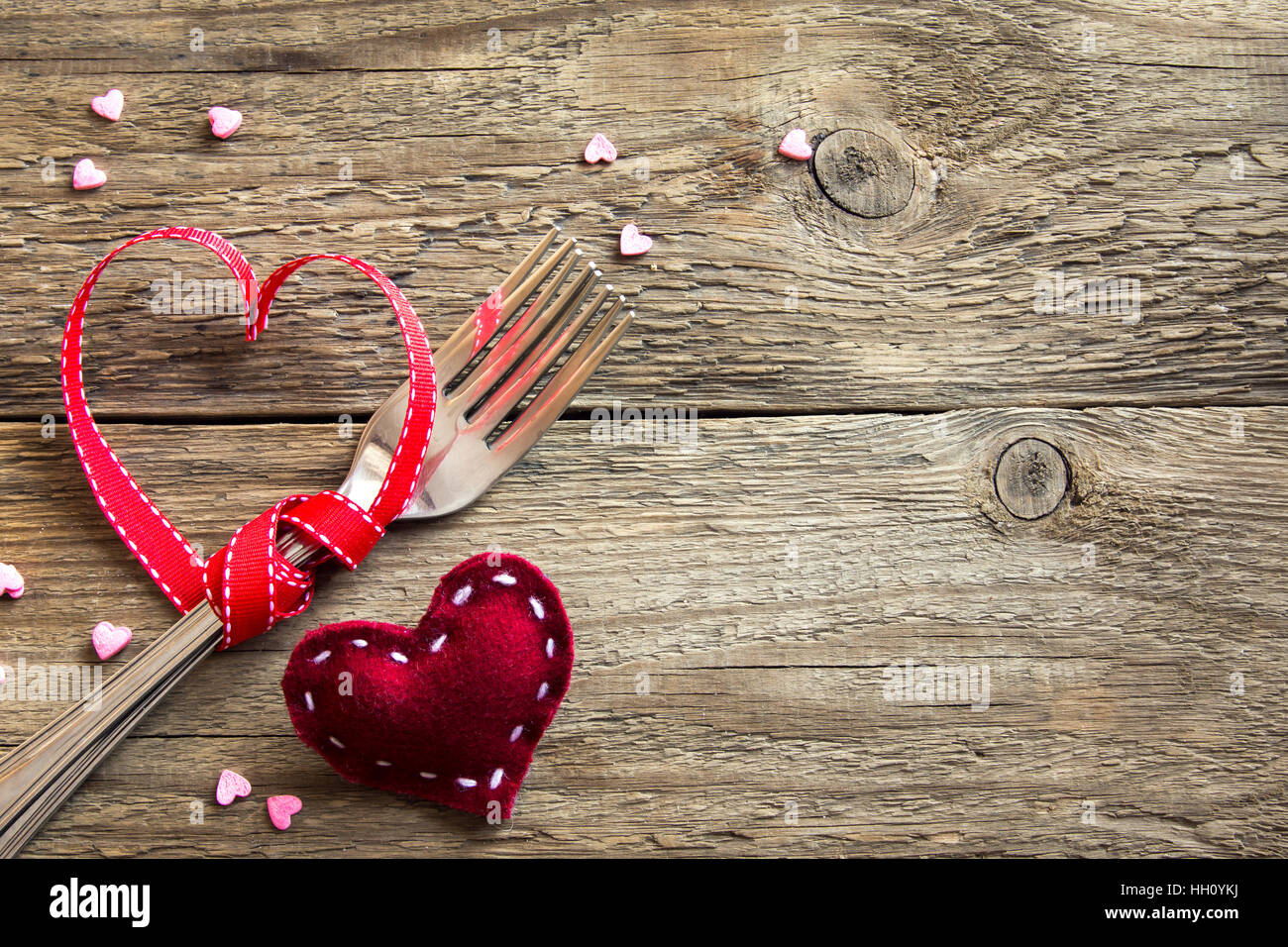 Table setting (two forks) for Valentine\u0027s Day with red hearts on rustic wooden background with copy space. Love romance love to eat or Valentine\u0027s d & Table setting (two forks) for Valentine\u0027s Day with red hearts on ...