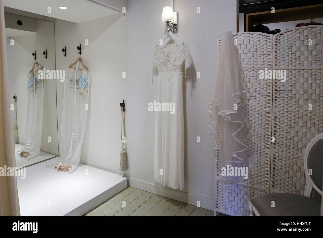 White wedding gowns in a charity shop - Stock Image