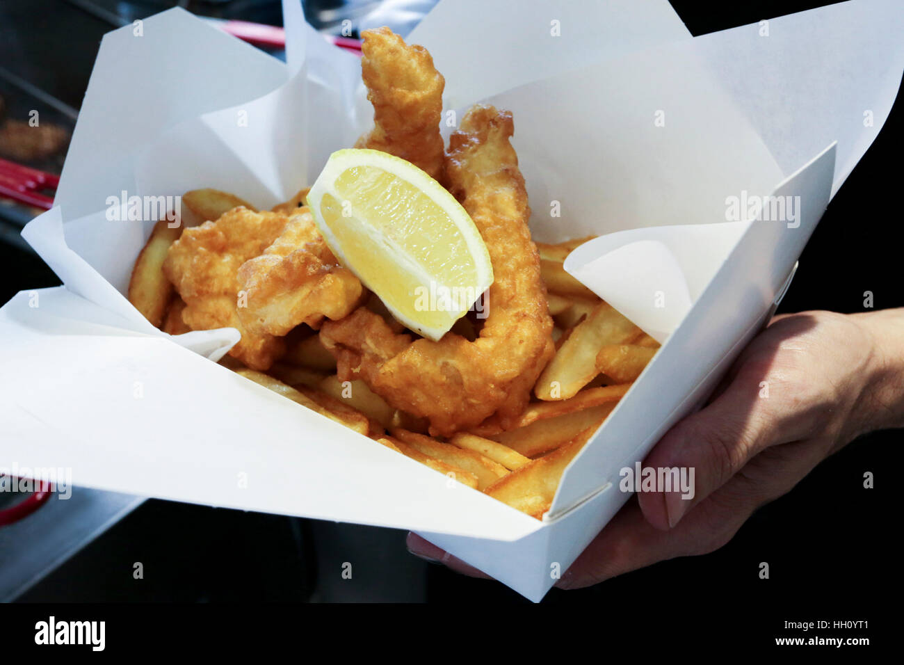 Fish and chips snack in cardboard box - Stock Image