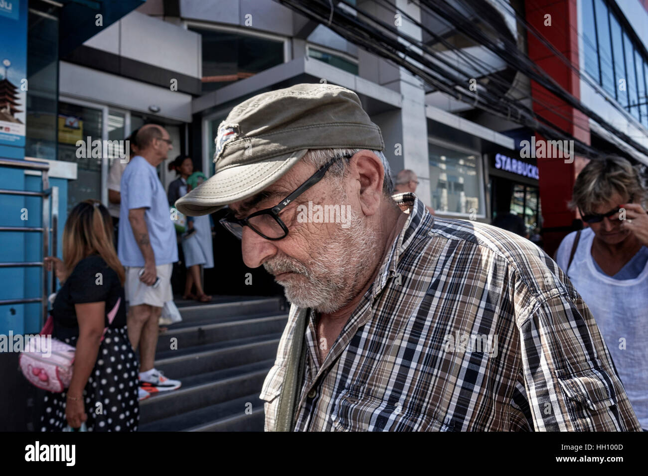Elderly man pondering in thought - Stock Image