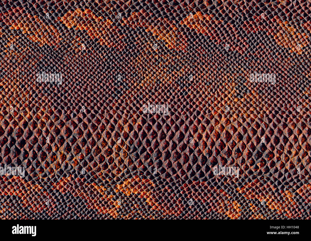 full frame scaled abstract brown patterned reptile skin surface - Stock Image