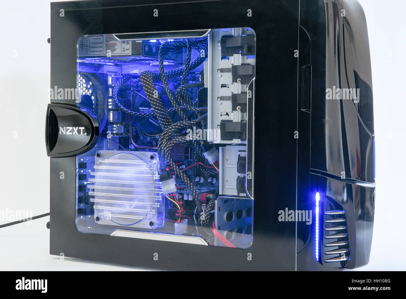 Illuminated computer hardware with a look inside the box - Stock Image