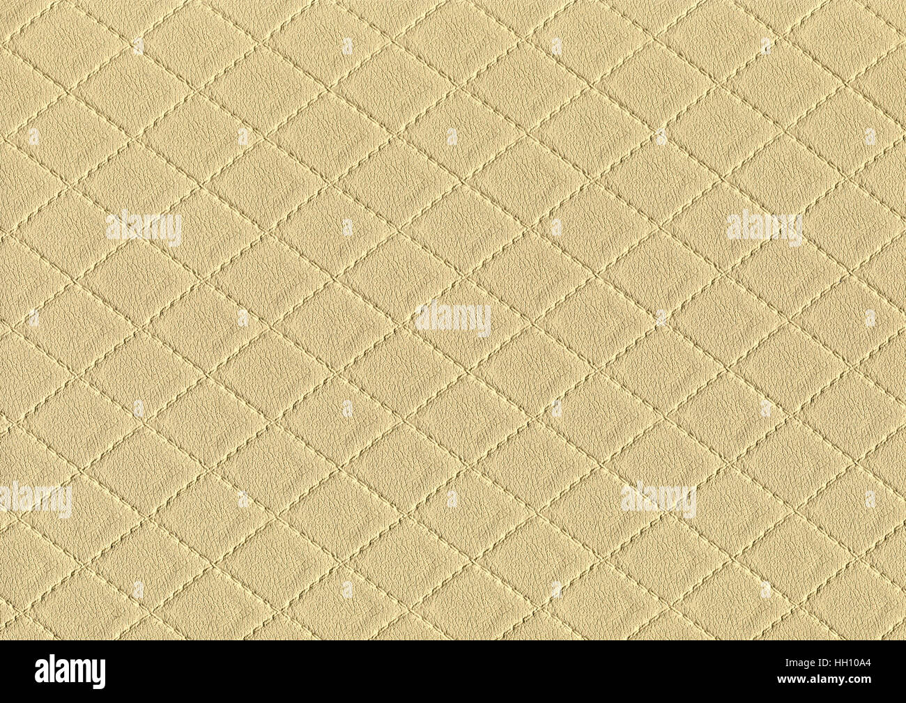 a full frame abstract stitched fawn leather background - Stock Image