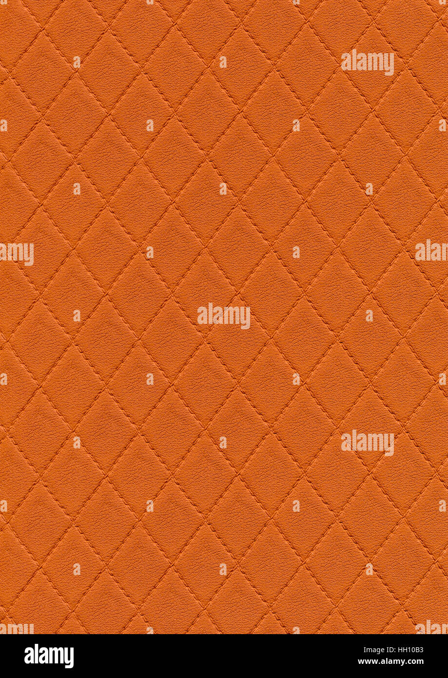 a full frame abstract stitched orange leather background - Stock Image