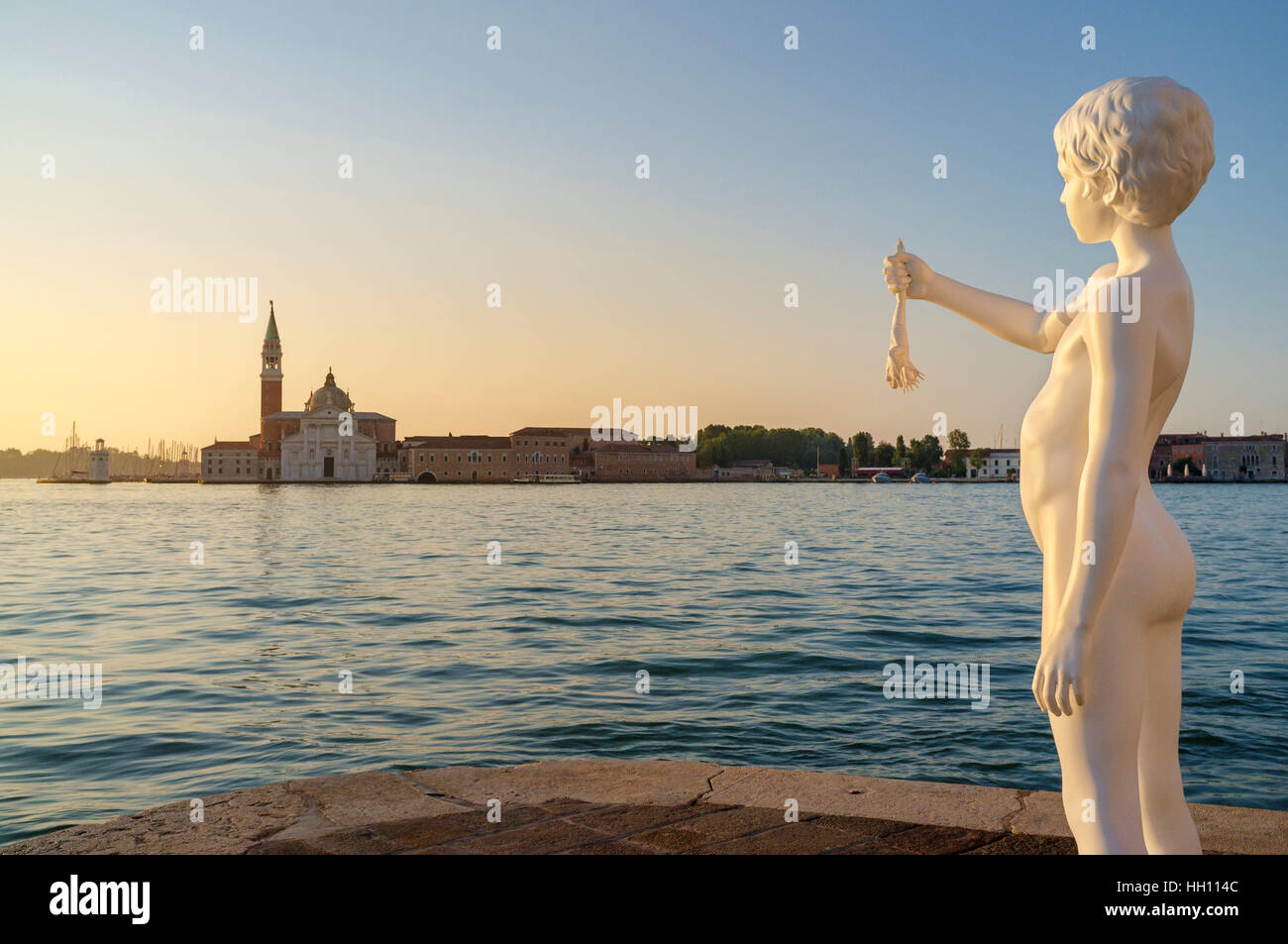 Boy With a Frog on Fondamenta Salute at the tip of Dorsoduro Venice - Stock Image