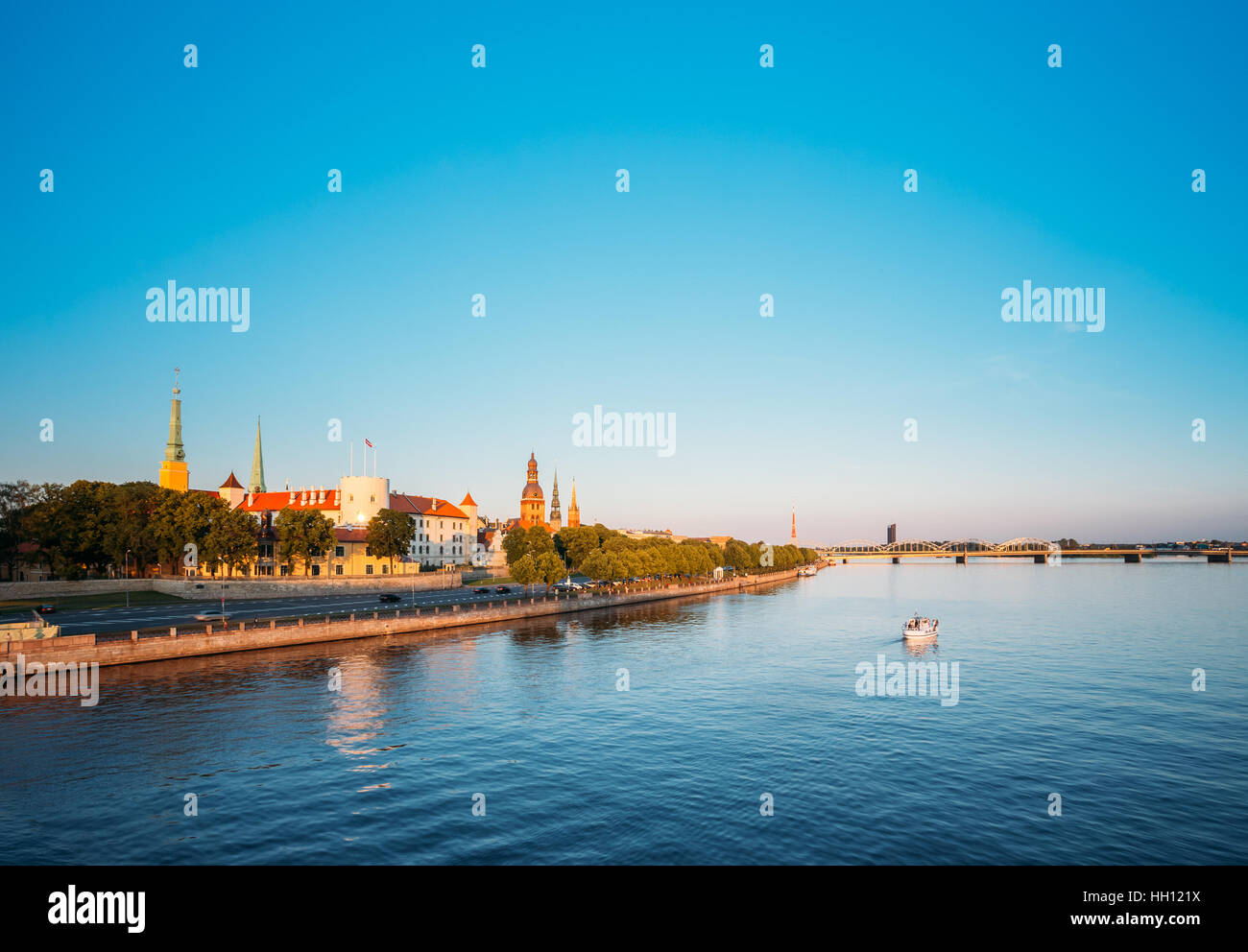 Scenic View To Promenad Of Daugava, In Riga, Latvia. Old Church Towers And Medieval Castle On Background. Seafront Stock Photo