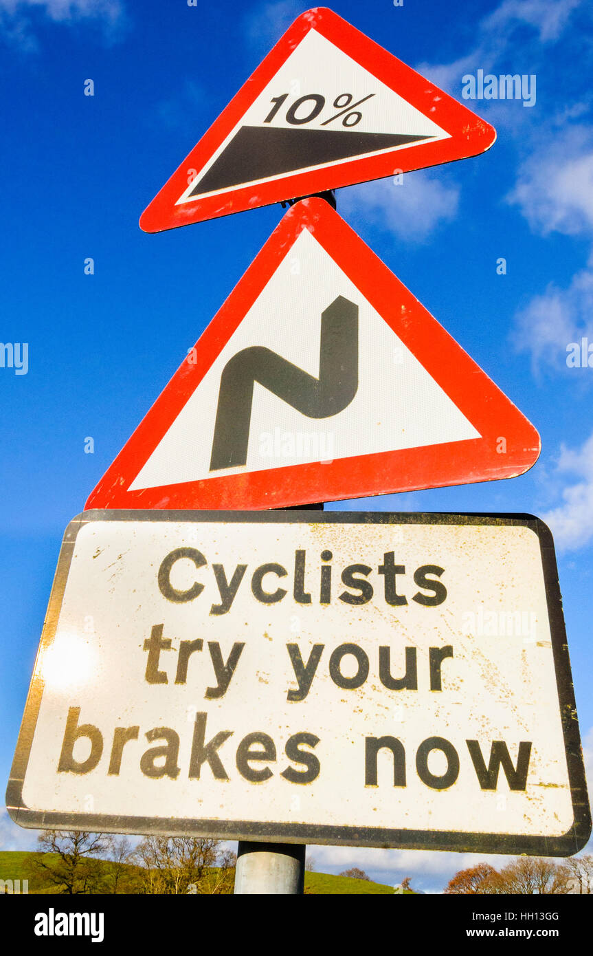 Warning to cyclists before steep descent at Hawkshead Moor in the Lake District - Stock Image