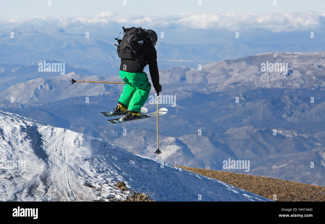 Granada, Spain. 13th of January, 2017. Kevin Blanc professional freeride skier jumps over the landscape of Granada. - Stock Image