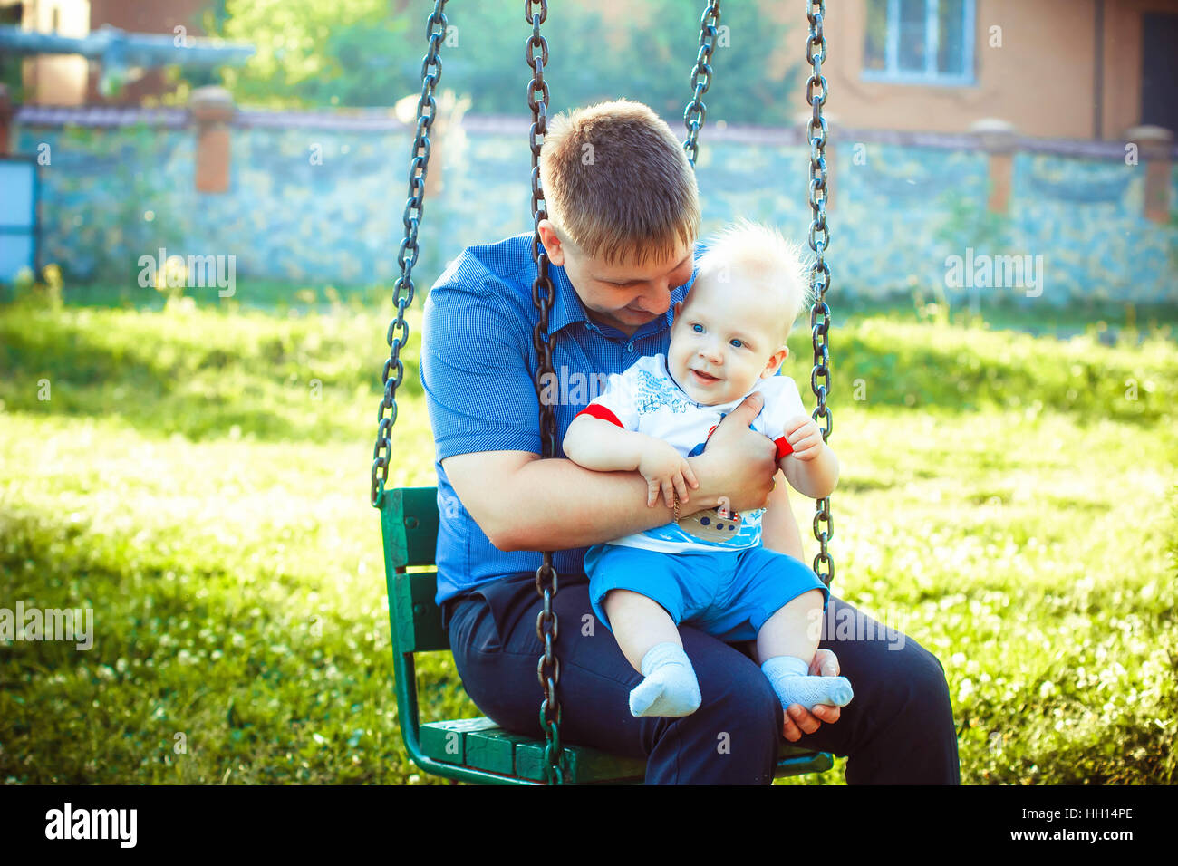 father, embracing the child on your lap - Stock Image