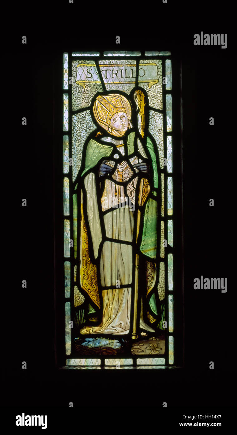 Modern stained glass depicting Breton missionary St Trillo above the altar & well chamber in the C12th chapel - Stock Image