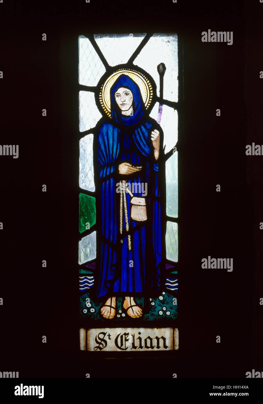 Modern stained glass depicting C6th Cornish or Breton missionary St Elian in the well chapel of St Trillo at Rhos - Stock Image