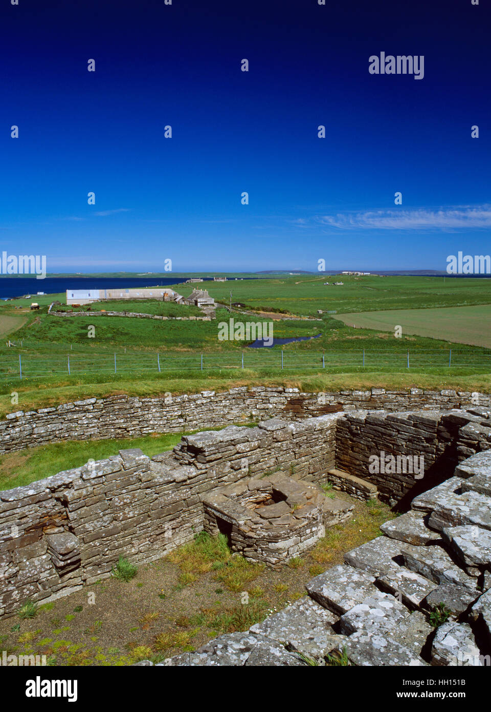 View NE from the keep of Cubbie Roo's Castle, over an outbuilding with an oven, to the Bu of Wyre farm & Egilsay Stock Photo