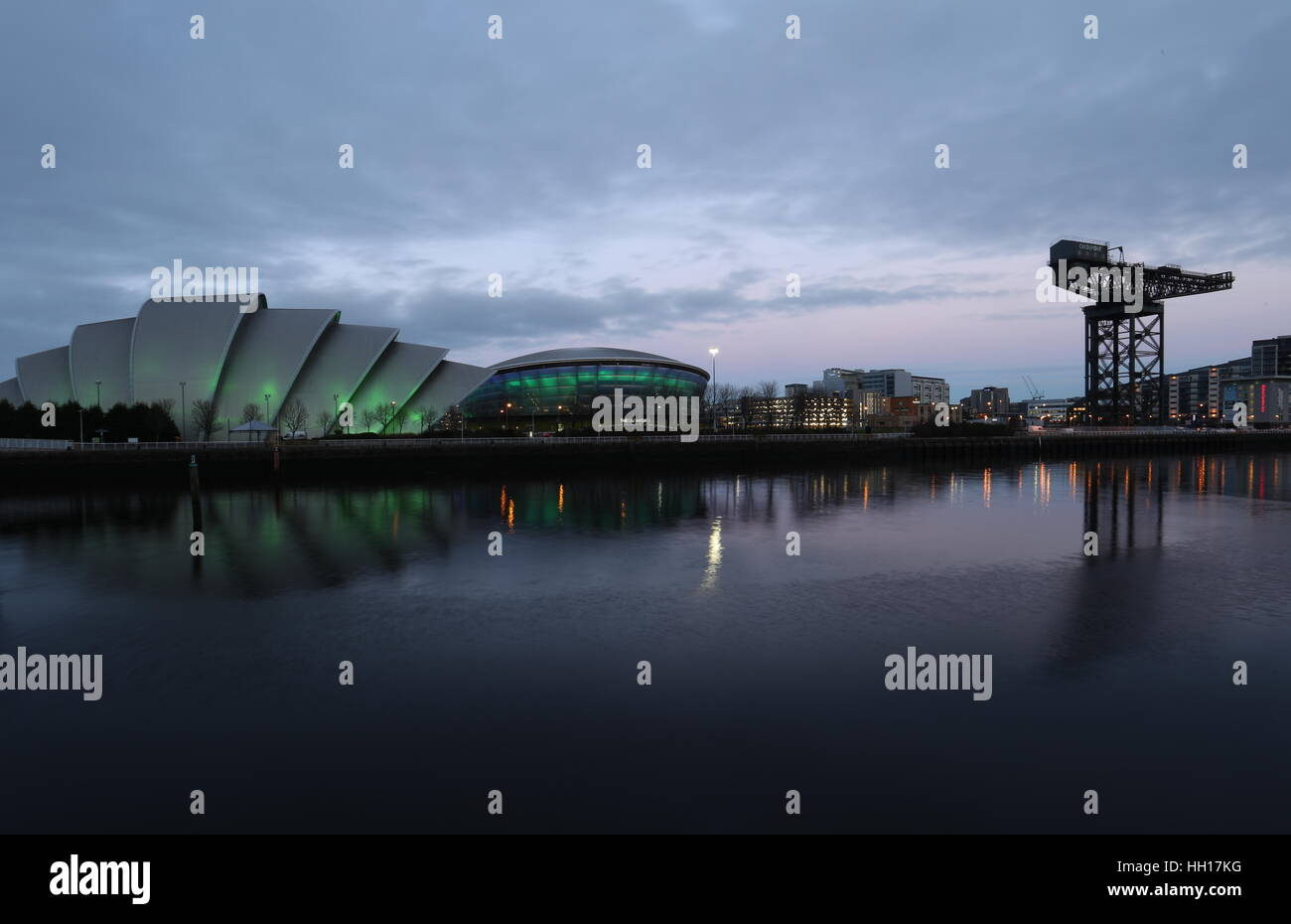 Clyde Auditorium and SSE Hydro and Finnieston Crane reflected in River Clyde at dusk Glasgow Scotland  January 2017 - Stock Image