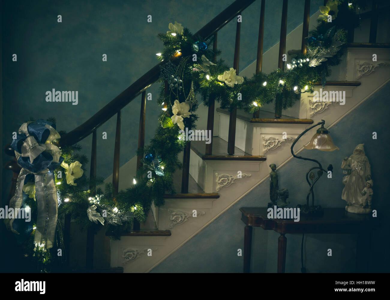 Christmas garland going up staircase - Stock Image