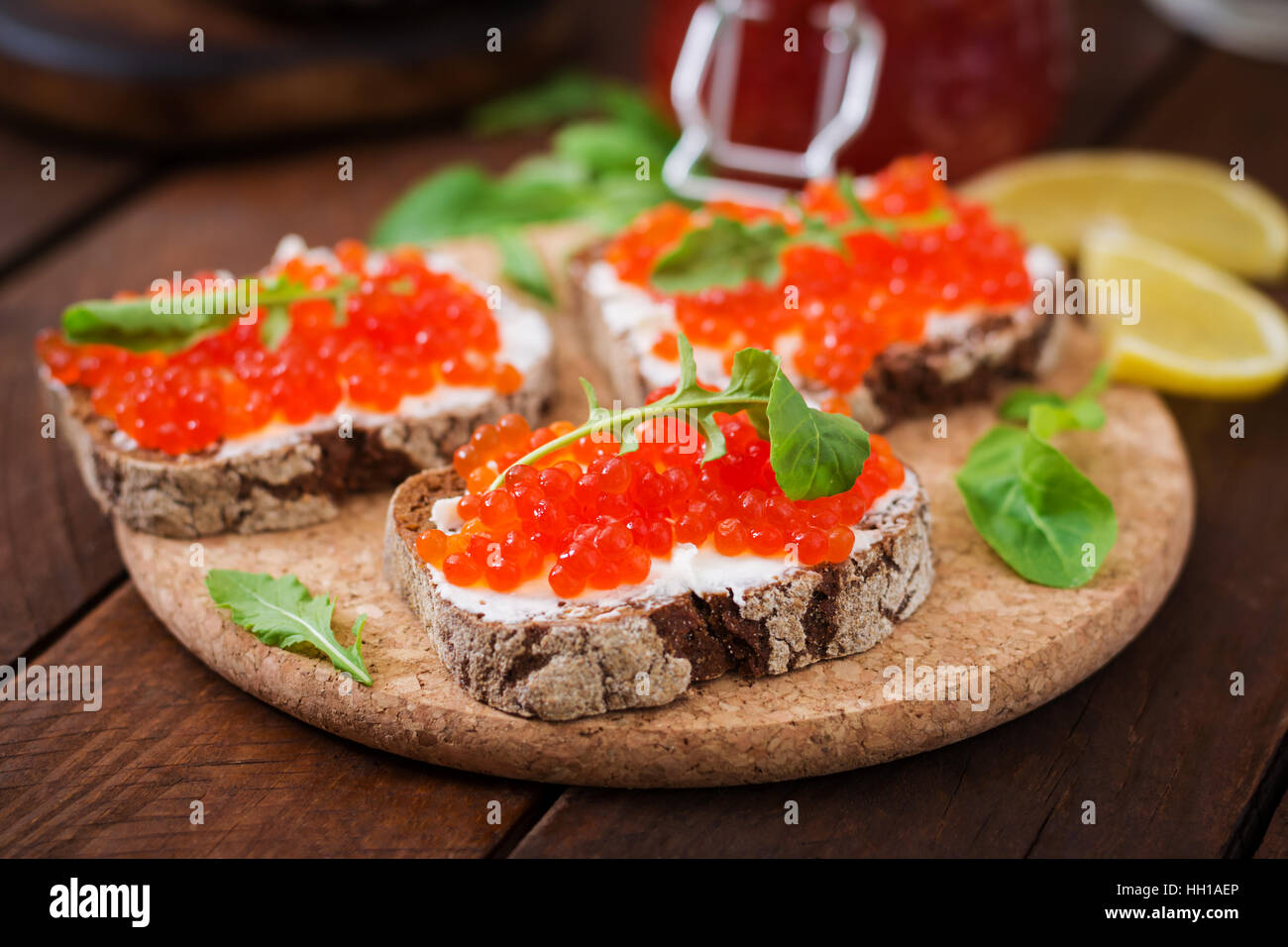 Sandwich with red caviar - Stock Image
