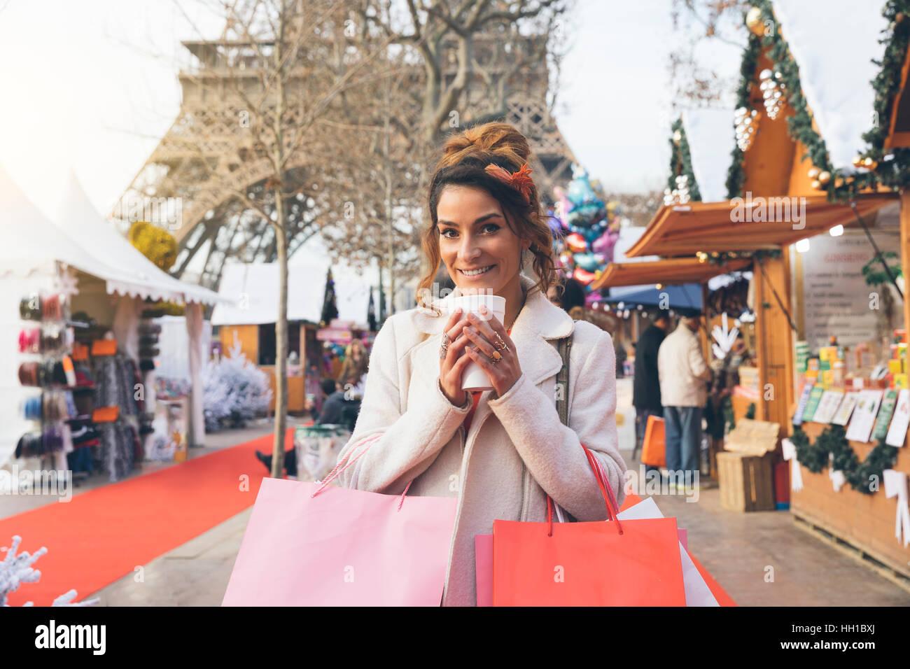 Paris, Woman doing shopping in Christmas market - Stock Image