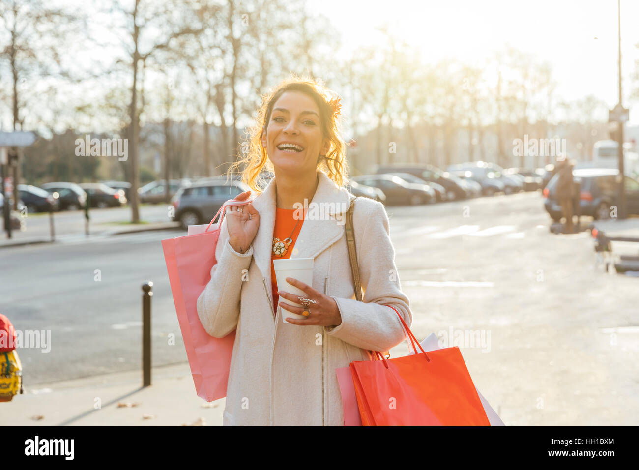 Paris, Attractive woman walking in the street - Stock Image