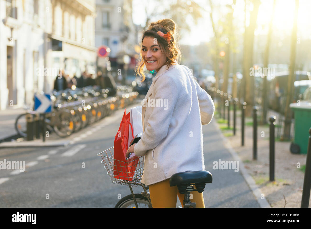 Paris, Woman riding a Velib in Paris street - Stock Image