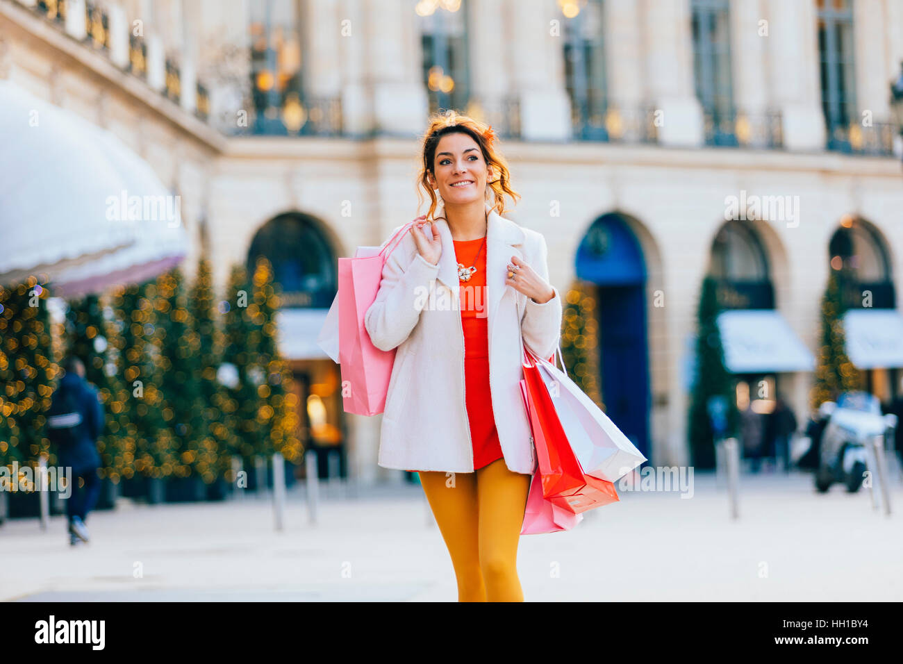 Woman doing shopping in Paris, Place Vendome Stock Photo