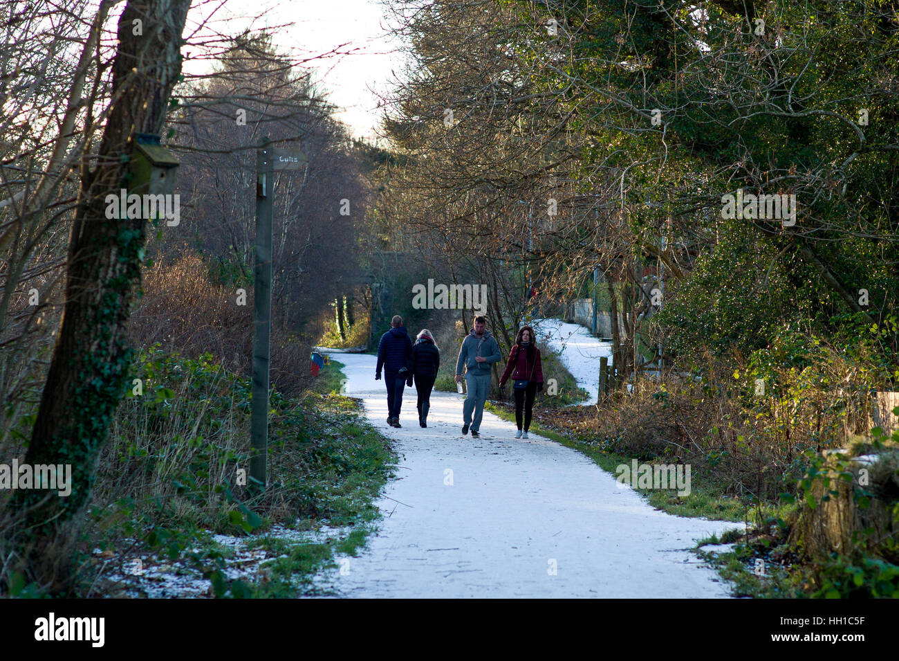 Walkers  on the Deeside way at Cults, Aberdeen. Former Royal Deeside Railway line running from Aberdeen to Ballater - Stock Image