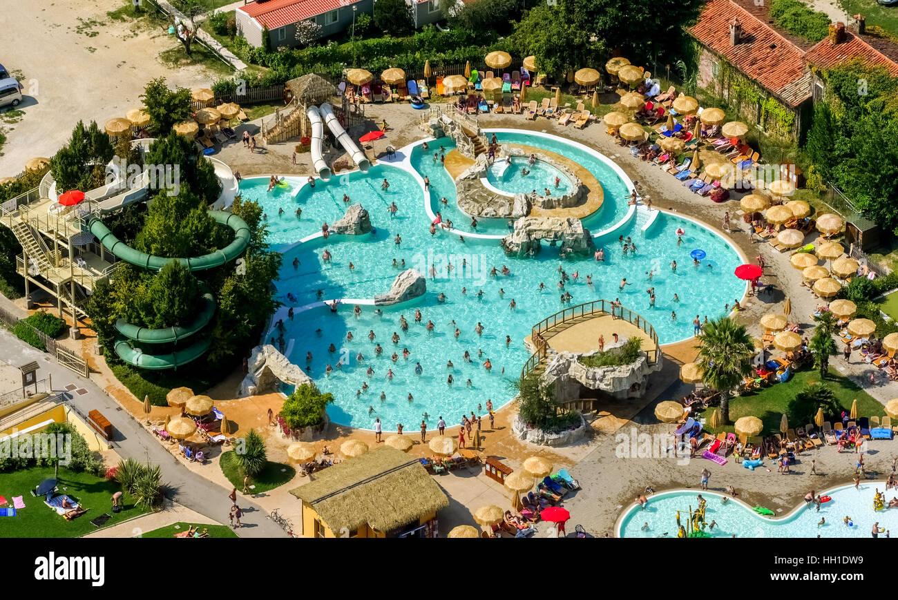 Aerial view of Piani di Clodia Camping, campsite, swimming pool and sun terrace with parasols, campers, Lake Garda, Stock Photo