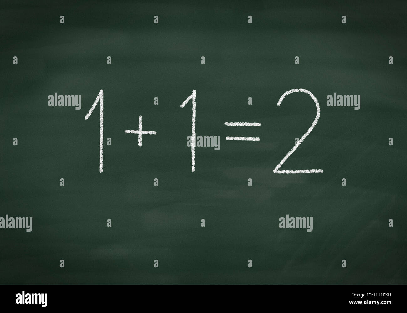 Simple maths on a chalkboard Stock Photo: 130955405 - Alamy