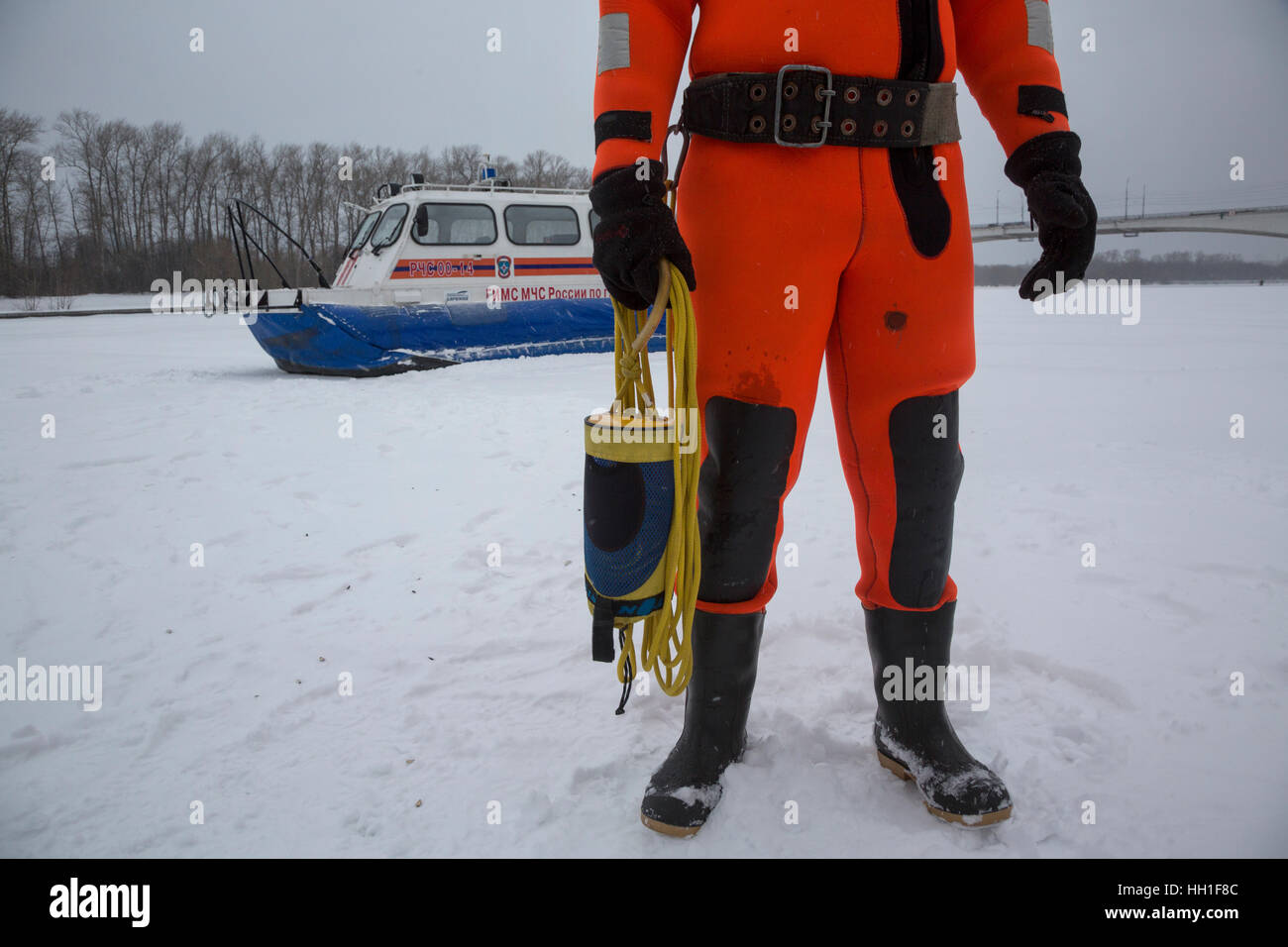 Diver-lifesaver of Russian Emergencies Ministry patrols the water of the river on winter season in Moscow, Russia - Stock Image