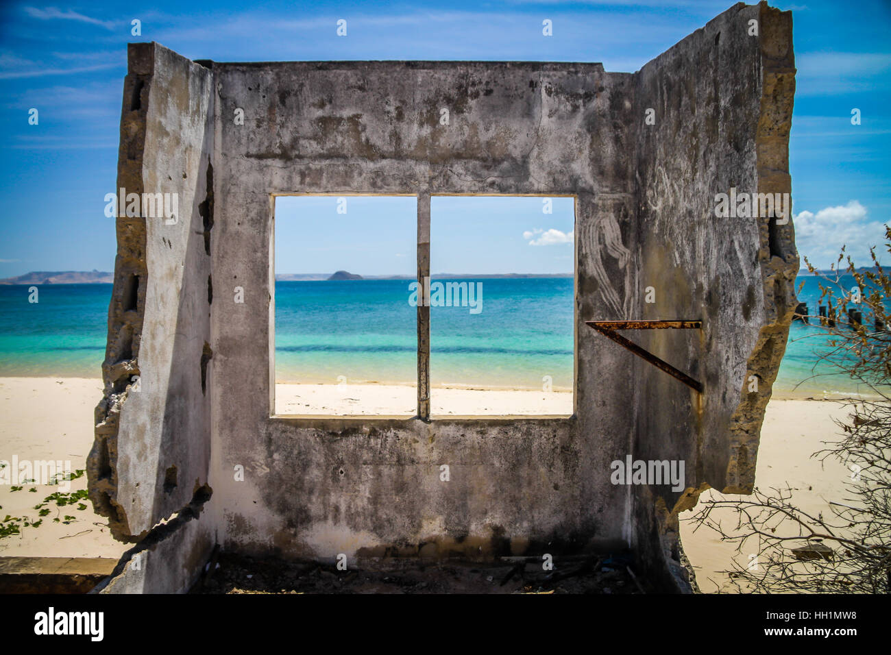 Remains of the building destroyed by the ocean on the northern coast of Madagascar, near Diego Suarez - Stock Image