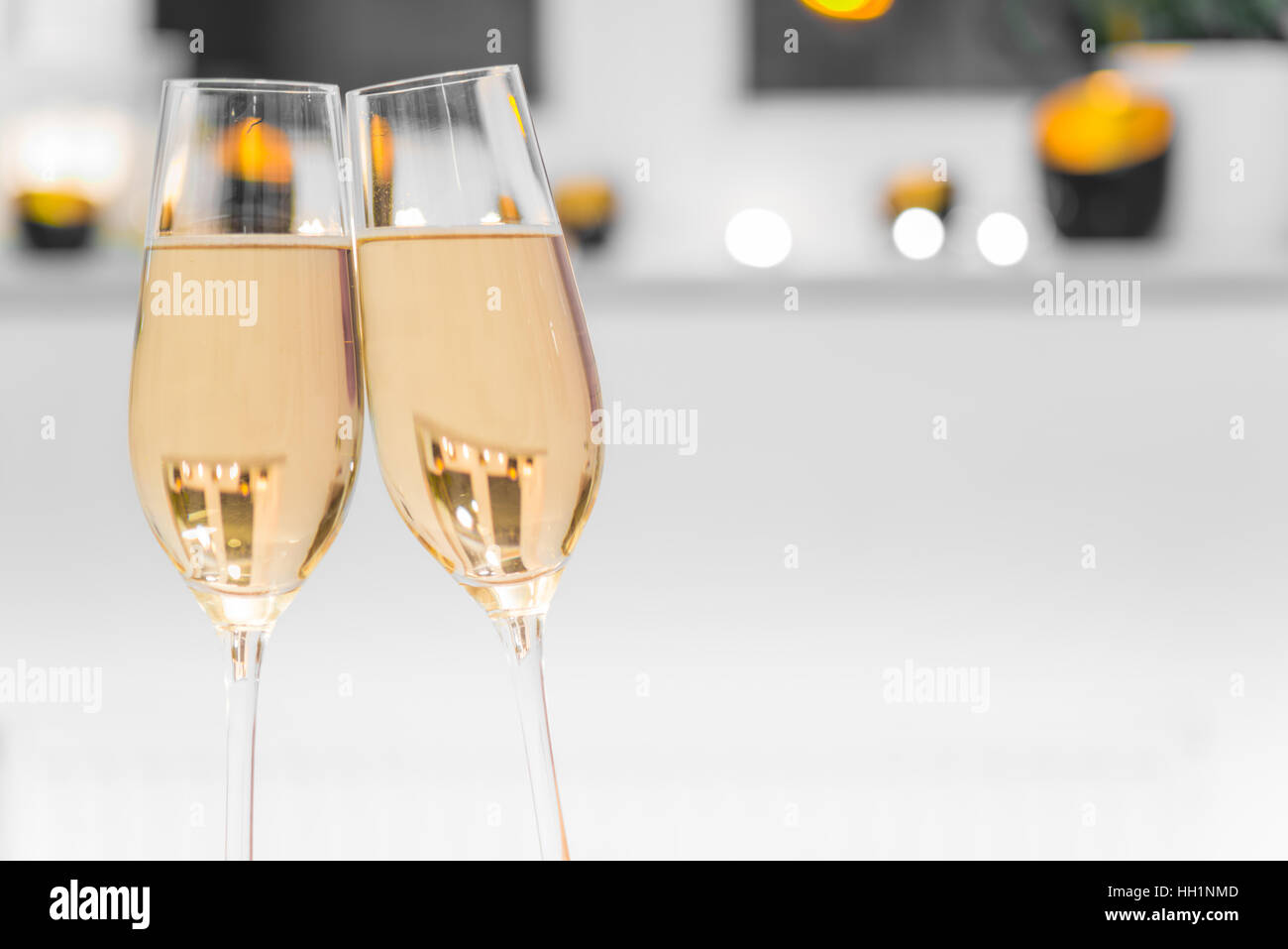 Closeup of two glasses filled with champagne - Stock Image
