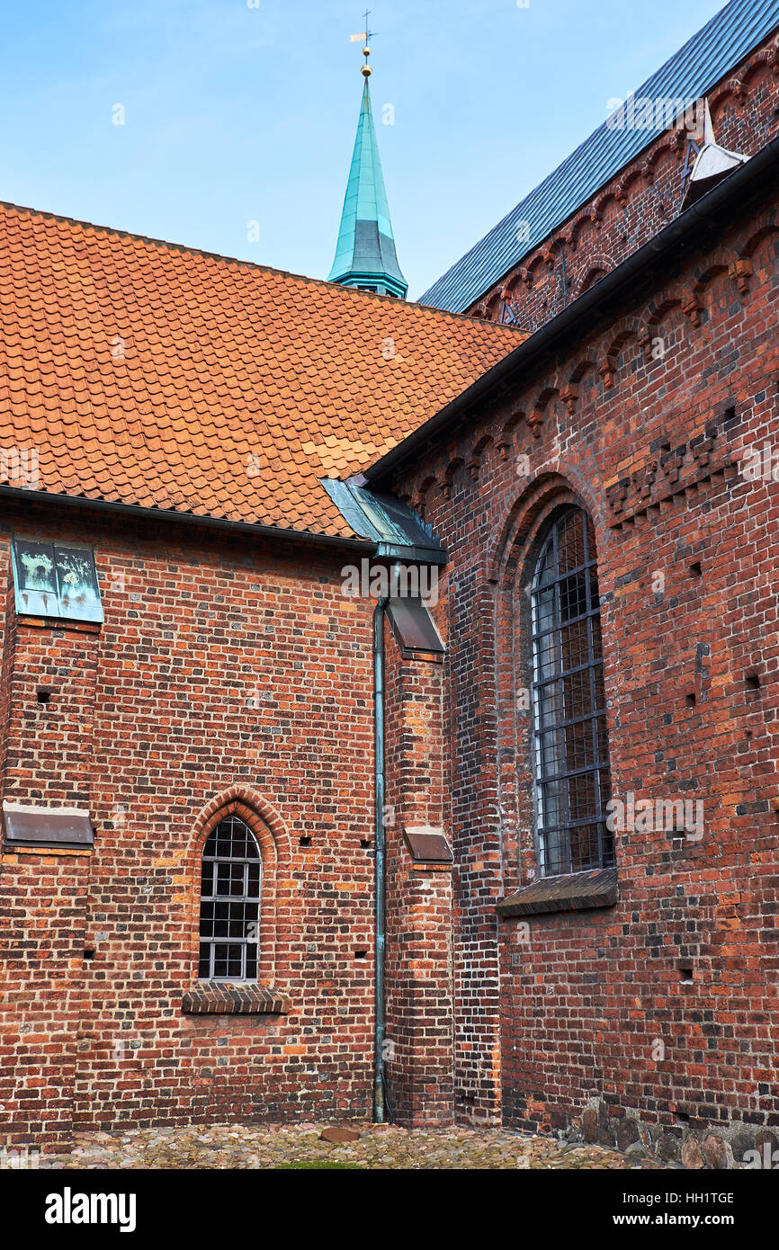 Details of Elsinore Cathedrals gothic architecture in red brick masonry and arched windows - Stock Image