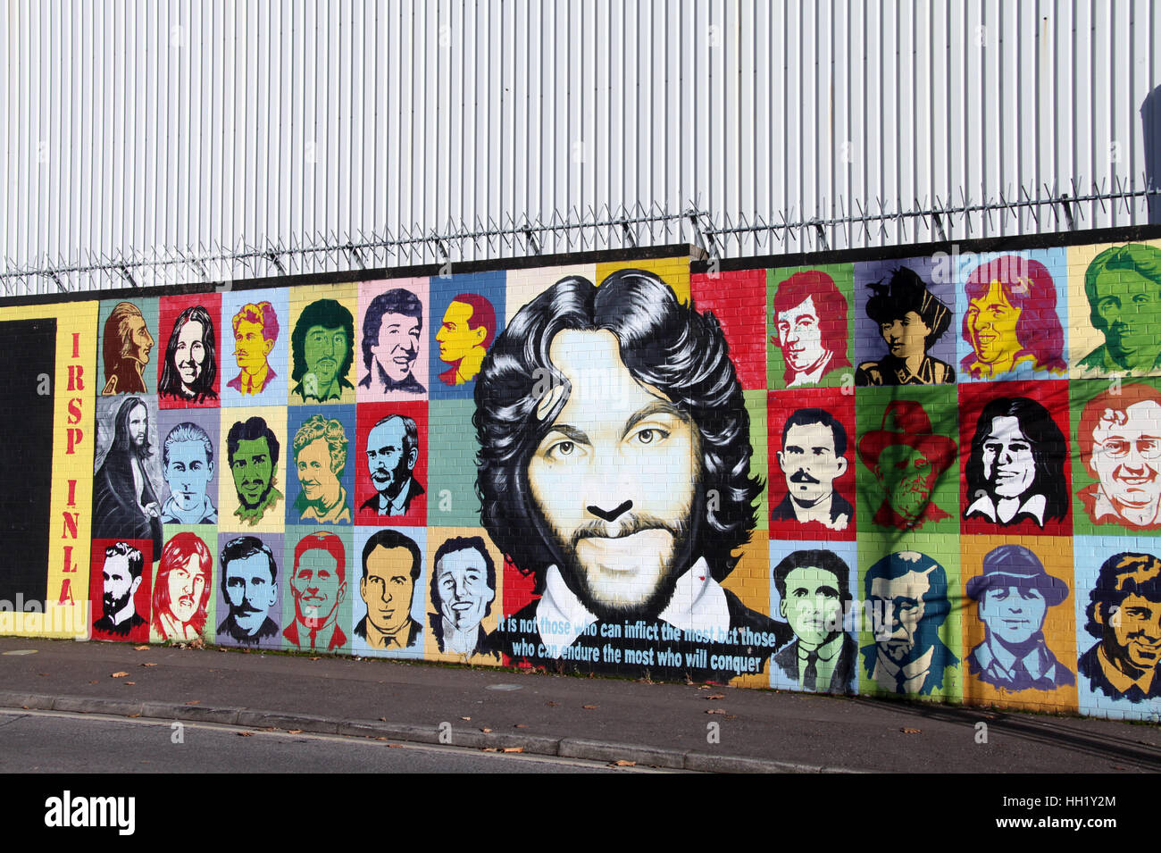 International Peace Wall on the Falls Road in Belfast - Stock Image