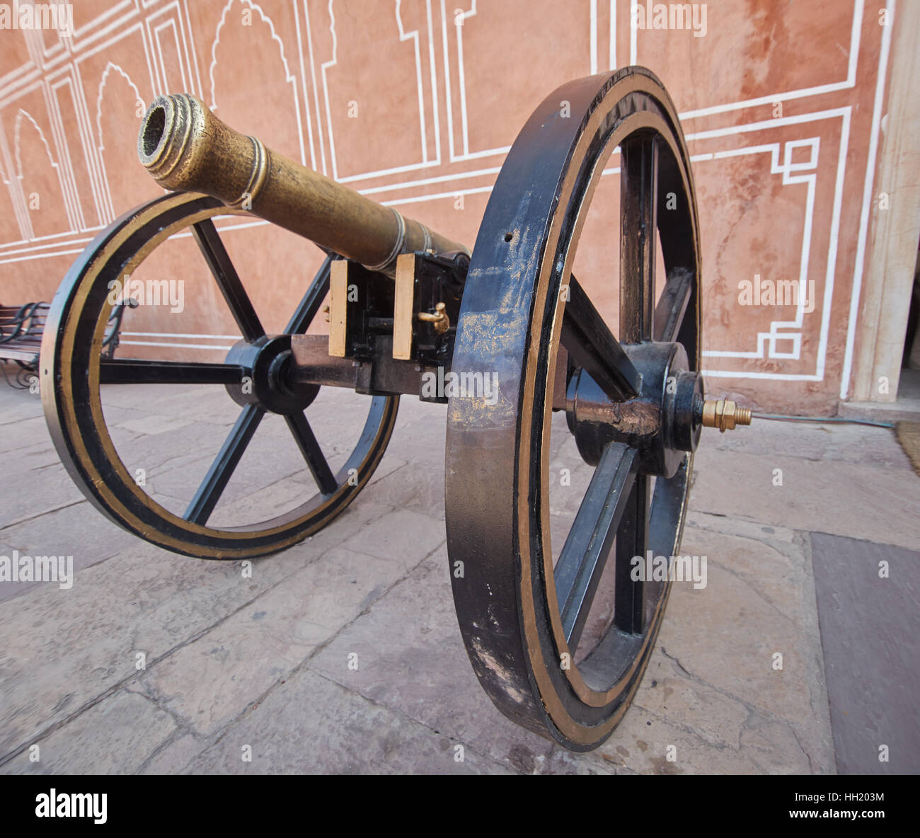 Black cannon in pink Jaipur City Palace Stock Photo