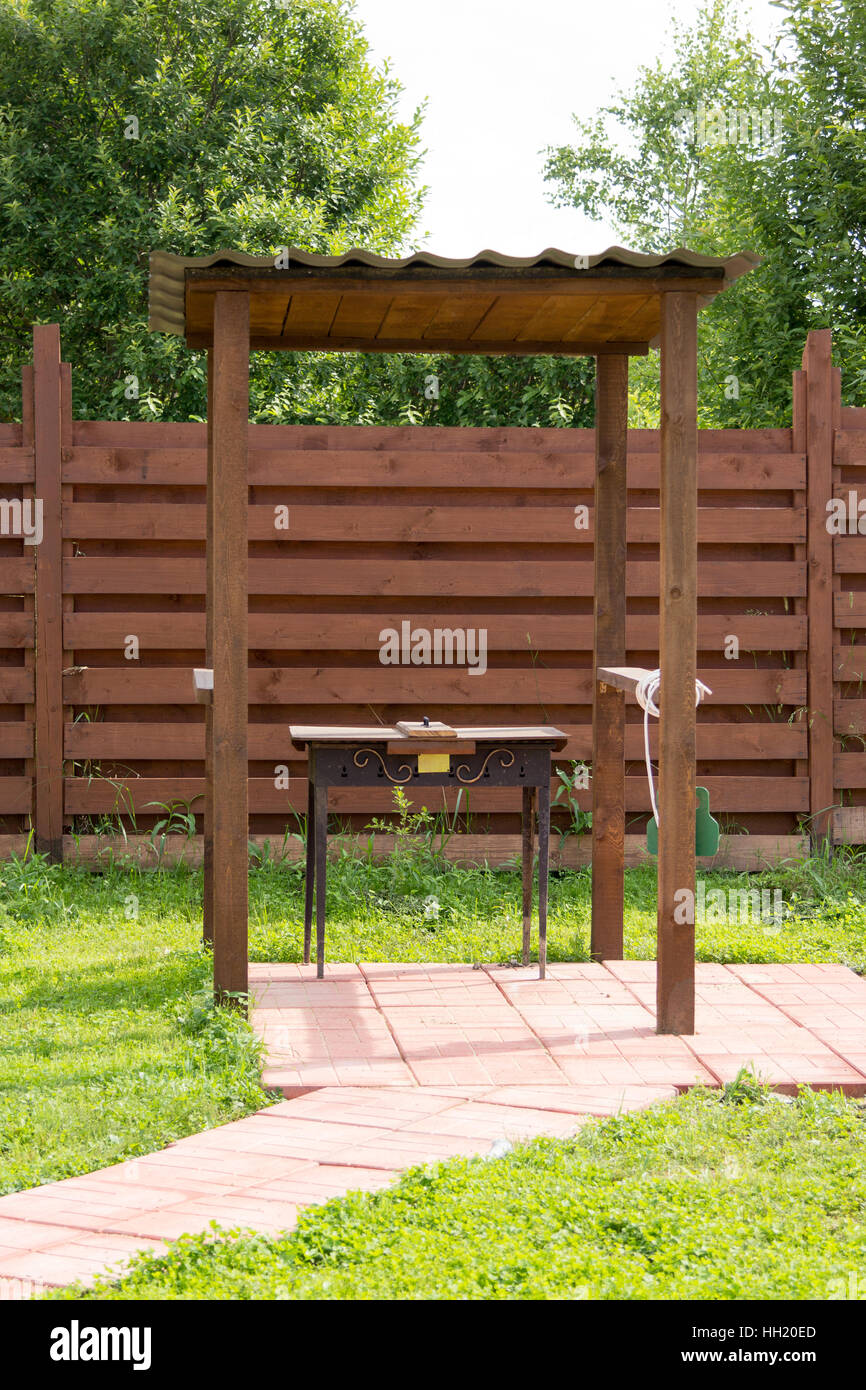 BBQ on site under a wooden canopy & BBQ on site under a wooden canopy Stock Photo: 130966037 - Alamy
