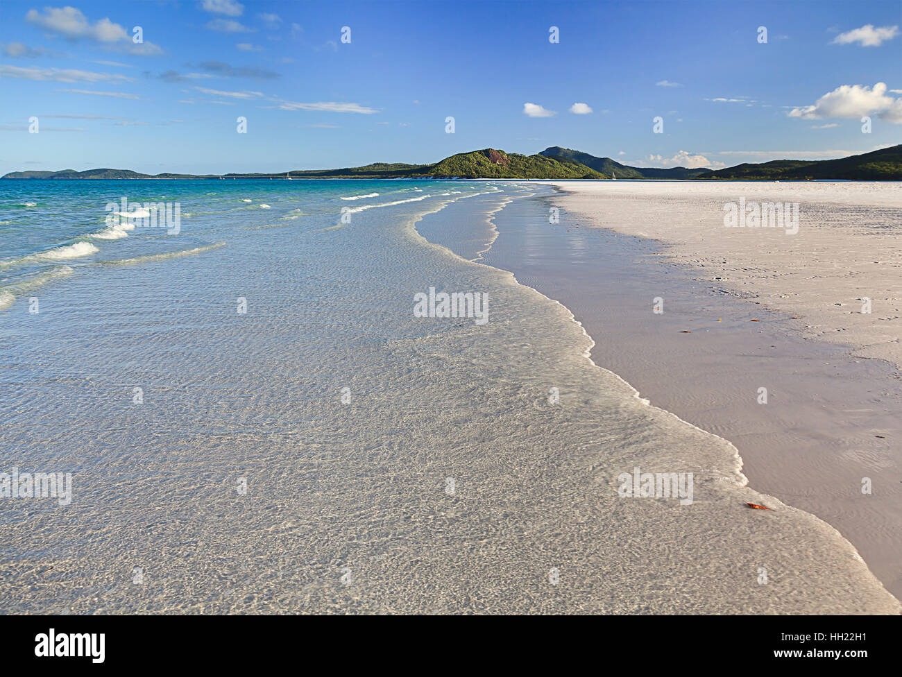 Whitehaven white silica sand beach on WHitsunday island in Coral sea of Pacific Australia. Tropical paradise from - Stock Image
