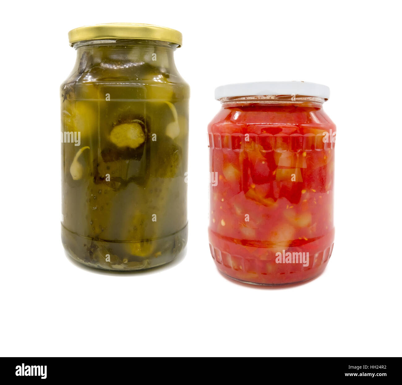 Pickled cucumbers and peppers in tomato sauce in jar Stock Photo