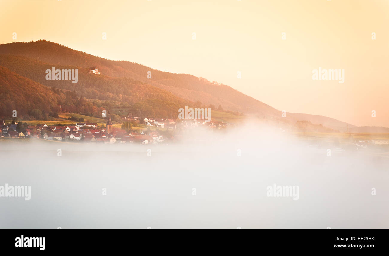 Village with clouds at dawn, Pfalz, Germany Stock Photo