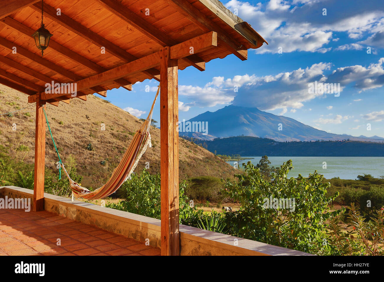 hammock on a patio with volcano in the background in Ibarra, Ecuador - Stock Image