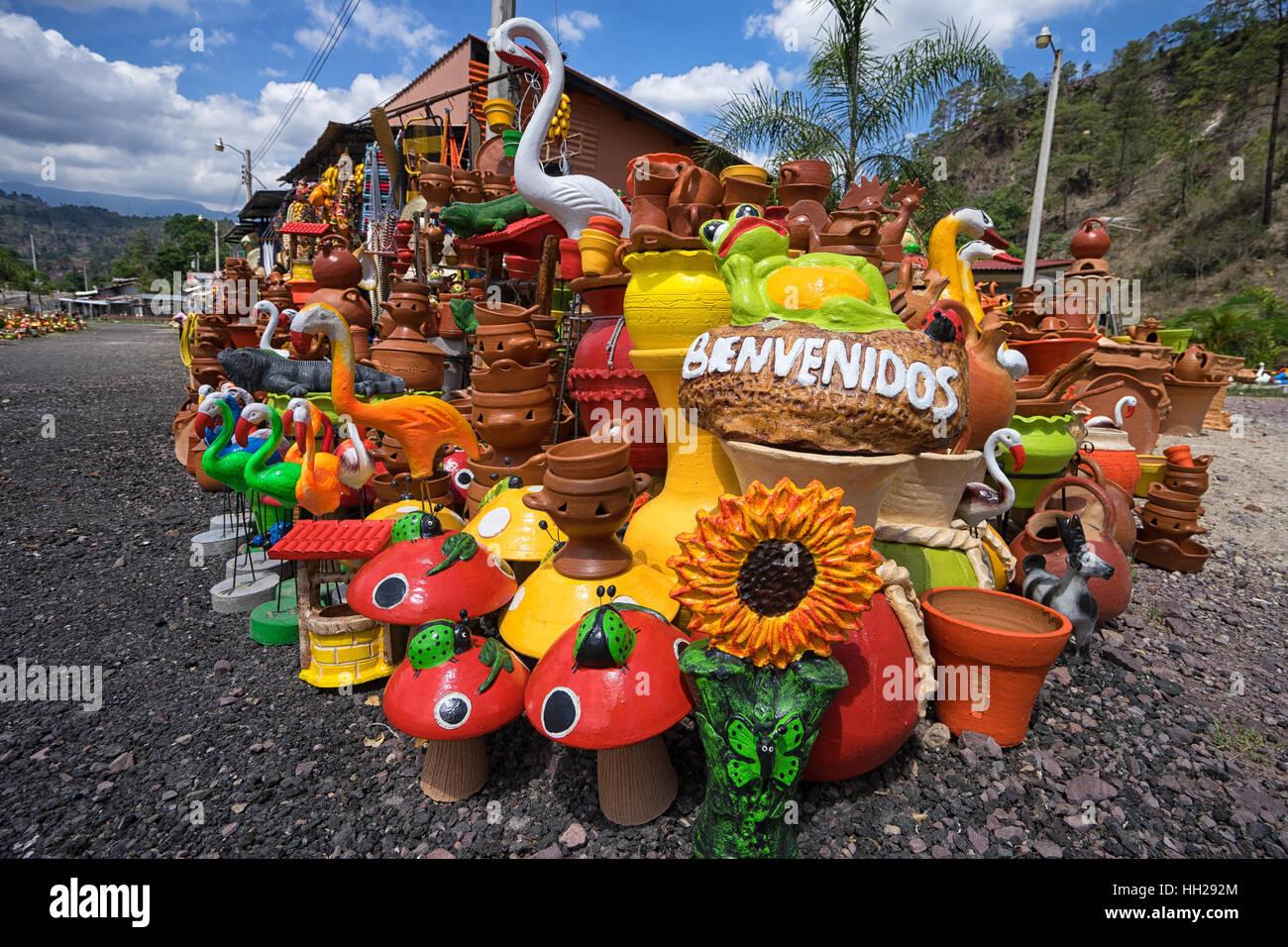 Roadside colorful artisan pottery in Honduras - Stock Image