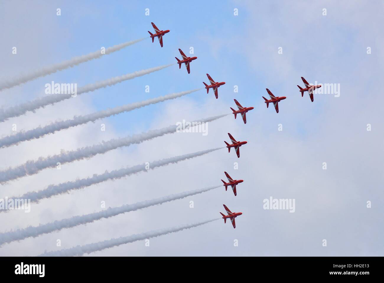The Royal Air Force Red Arrows aerobatic team  in swan formation - Stock Image