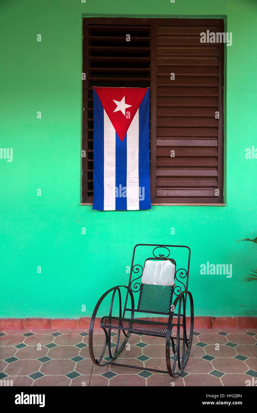Cuban flag with rocking chair in a house in Vinales, Cuba - Stock Image