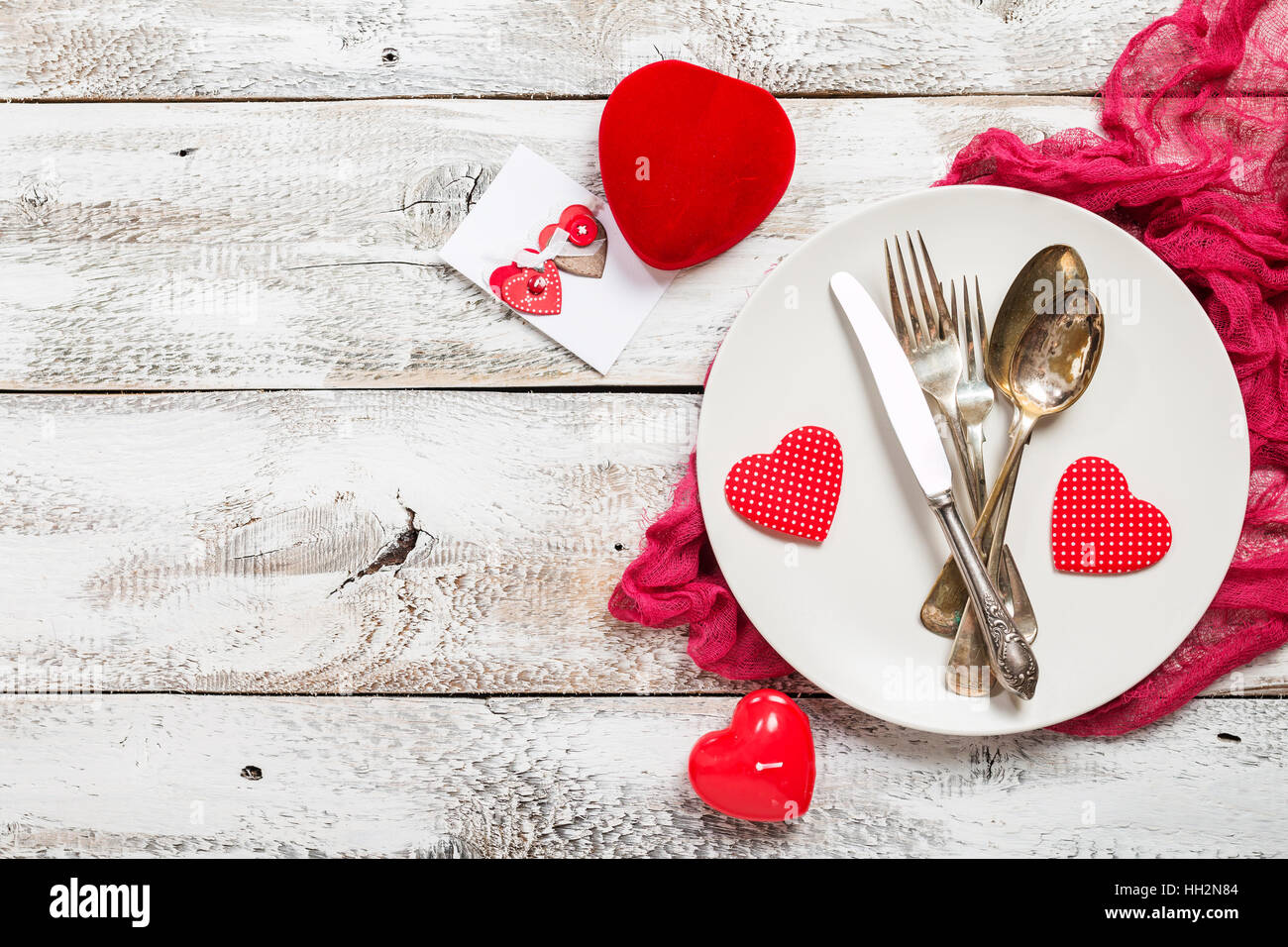 Valentine\'s day table setting. Table set with plate, knife, spoon ...