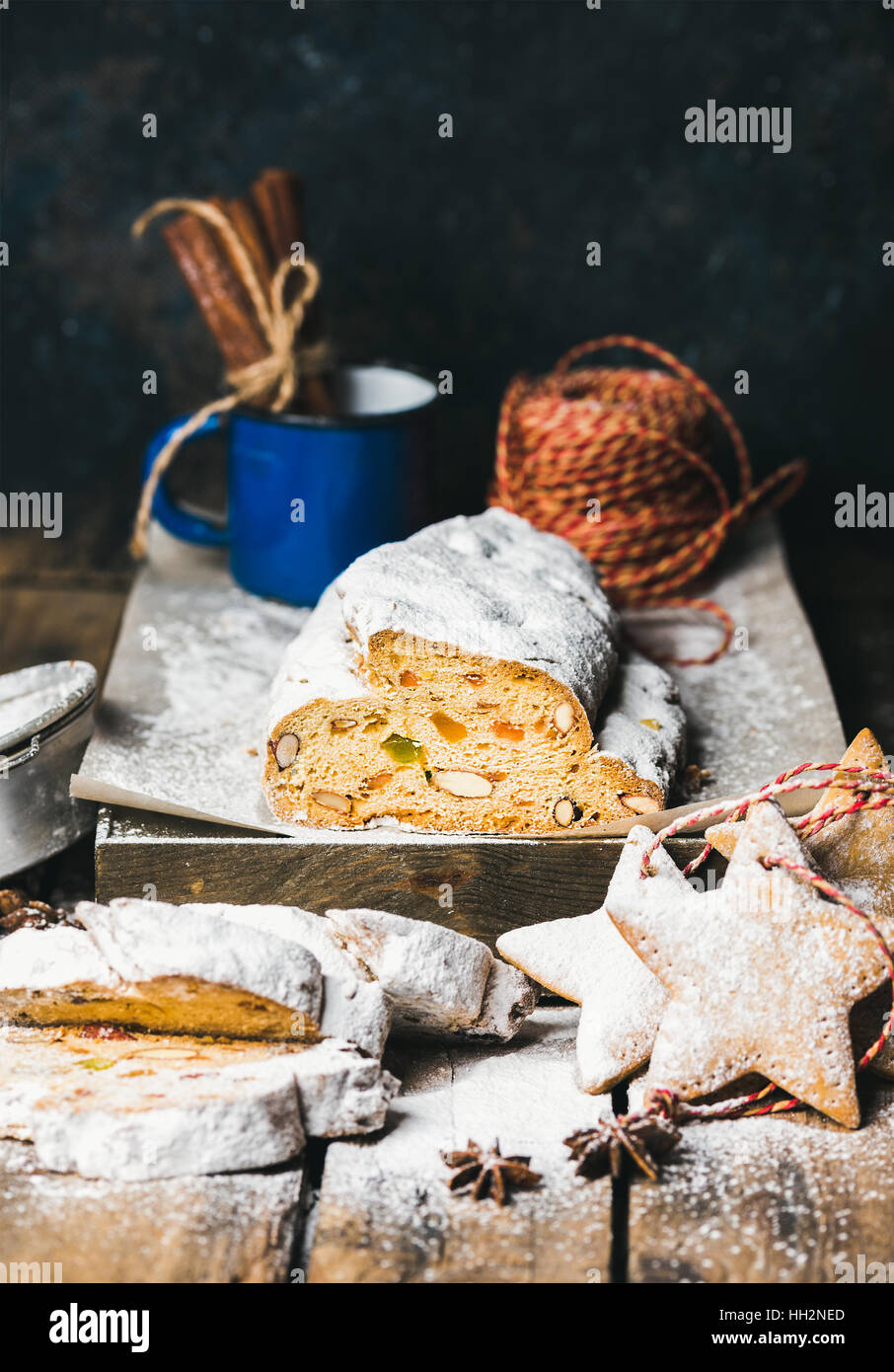 Traditional German Christmas cake Stollen with festive gingerbread cookies - Stock Image