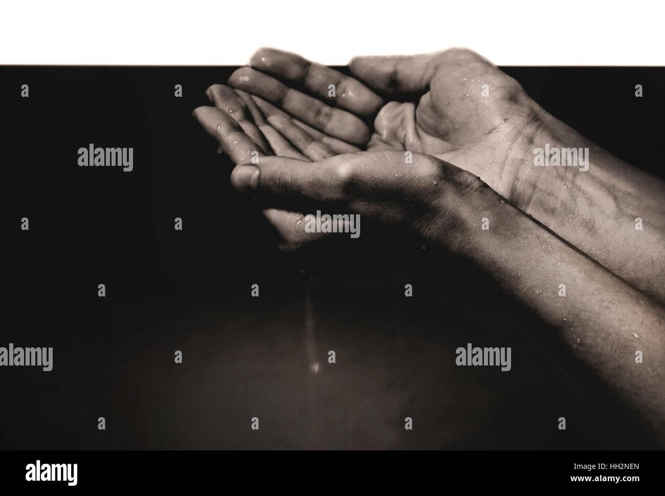hands in oil - Stock Image