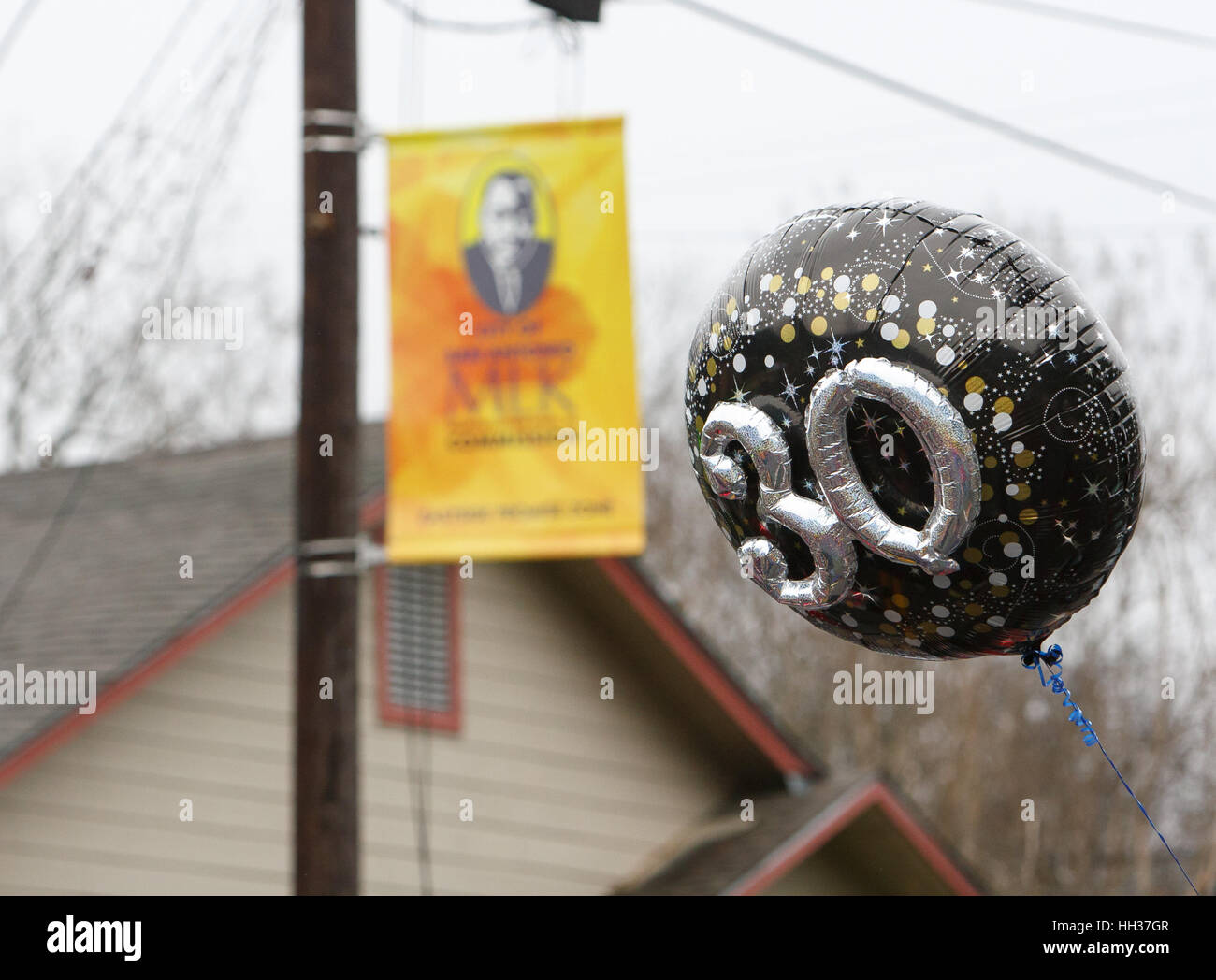 San Antonio, USA. 16th January, 2017. A balloon carried by a marcher emphasizes the 30th anniversary of the annual Stock Photo