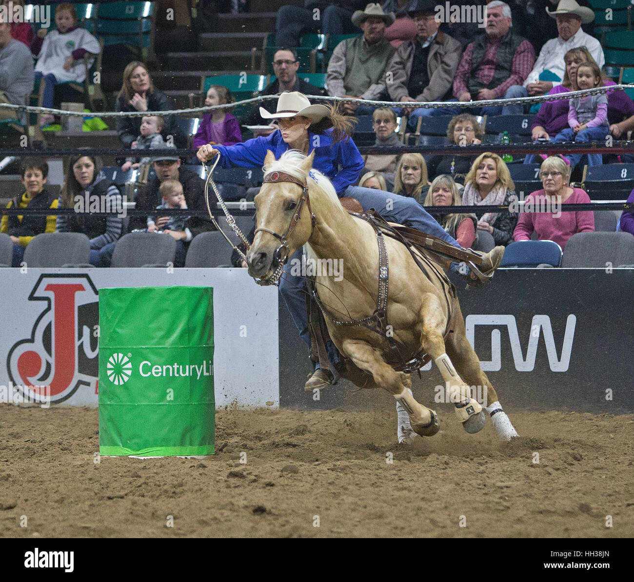 Denver, USA. 16th Jan, 2017. Barrel Racer Kathy Korell-Rach of CO makes her run around the 1st. barrel during the - Stock Image